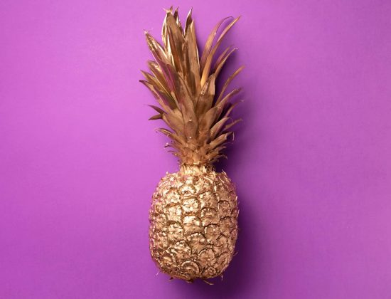 creative-layout-gold-pineapple-on-violet-backgroun-NJ6LXD5-scaled.jpg